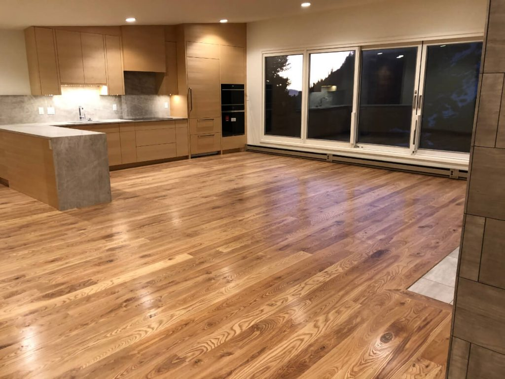Sandy Condo Remodeling with Ash Hardwood Flooring